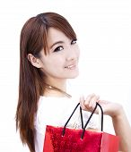 beautiful asian woman holding shopping bag with white background