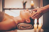 Spa woman Massage. Face Massage in beauty spa salon. Female enjoying relaxing body and facial massag poster