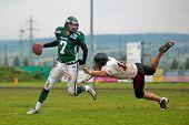 KORNEUBURG,  AUSTRIA - JUNE 20 Austrian Football League: QB Ryan Rufener (#7, Dragons) and his team win 41:35 against the Carinthian Black Lions on June 20, 2009 in Korneuburg, Austria.