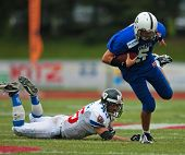 WOLFSBERG, AUSTRIA - AUGUST 22 American Football B-EC: QB Tommaso Monardi (#5, Italy) and his team lose 17:27 to the Czech Republic on August 22, 2009 in Wolfsberg, Austria.