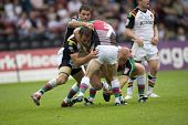 TWICKENHAM UK AUGUST 03, Danny Orr Danny Ward and Chad Randall tackle Simon Finnigan  Playing in the