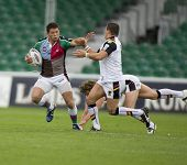 TWICKENHAM UK AUGUST 03,Henry Paul evades two tacklers  Playing in the Engage Super League Rugby lea