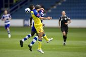 LONDON, UK AUGUST 2, Daniel Parejo and Andrea Mantovani jump for the ball at the pre-season friendly