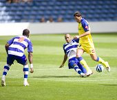 LONDON, UK AUGUST 2, Fitz Hall tackles Erjon Bogdani at the pre-season friendly football match betwe