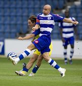 LONDON, UK AUGUST 2,Gavin Mahon muscles Vincenzo Italiano off the ball at the pre-season friendly fo