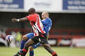 LONDON, UK AUGUST 16, Ryan Bennett and Nathan Elder tussle for a ball playing in the Coca-Cola football league two match between Brentford and Grimsby town at Griffin Park London August 16, 2008