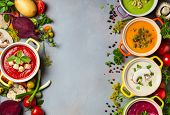 Variety of colorful vegetables cream soups and ingredients for soup. Top view. Concept of healthy ea poster