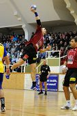 NAGYATAD, HUNGARY - FEBRUARY 5: Ferenc Ilyes (with the ball) in action at Hungarian Cup Handball mat