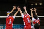 KAPOSVAR, HUNGARY - DECEMBER 8: Stojkovic (L), Nemec (C) and Guilherme (R) blocks the ball at a CEV