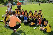 KAPOSVAR, HUNGARY - JULY 20: Unidentified players listen to their trainer at the V. Youth Football Festival match - July 20, 2009 in Kaposvar, Hungary.