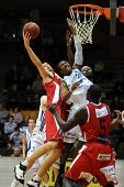 KAPOSVAR, HUNGARY - DECEMBER 17: Dejon Prejean (C) in action at Hungarian National Championship bask