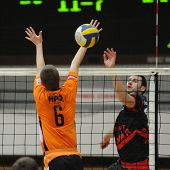 KAPOSVAR, HUNGARY - MARCH 1: Bito (L) and Skoric (R) in action at a Hungarian National Championship volleyball game Kaposvar vs. Szeged, March 1, 2010 in Kaposvar, Hungary.