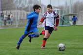 KAPOSVAR, HUNGARY - MARCH 6: Soma Ozorai (L) in action at the Hungarian National Championship under 13 game between Kaposvari Rakoczi FC and Mezga FC March 6, 2010 in Kaposvar, Hungary.