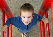 foto of swingset  - Child Having Fun Playing at the Playground - JPG