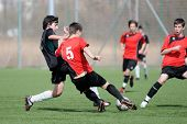 KAPOSVAR, HUNGARY - MARCH 21: Bellan (L) and Kovacs (5) in action at the Hungarian National Championship under 17 game between Kaposvari Rakoczi FC and Pecsi MFC March 21, 2010 in Kaposvar, Hungary.
