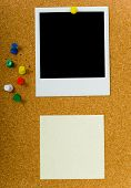 foto of bulletin board  - bulletin board with blank photograph and a yellow sticky or note and extra push pins - JPG