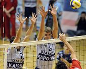 KECSKEMET, HUNGARY - APRIL 27: Koch (L) and Kovacs (C) strikes the ball at a Hungarian National Cham