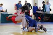 KAPOSVAR, HUNGARY - APRIL 17: Bence Kovacs (in blue) wrestle in the Hungarian Wrestling Cadet National Championship , April 17, 2010 in Kaposvar, Hungary.