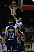 KAPOSVAR, HUNGARY - FEBRUARY 7: Laszlo Orosz (in white) in action at a Hugarian Cup basketball game