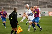 SZEKESFEHERVAR, HUNGARY - MARCH 17: Andre Alves (in white) in action at a Hungarian National Championship soccer game Kaposvar vs. FC Fehervar March 17, 2007 in Szekesfehervar, Hungary.