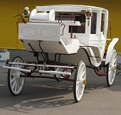 stock photo of cinderella coach  - white carriage white wedding ambulance without horses - JPG