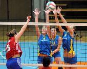 KAPOSVAR, HUNGARY - OCTOBER 3: Pinter (2) and Harmath (3) blocks the ball at the Hungarian NB I. League woman volleyball game Kaposvar vs Szolnok, October 3, 2010 in Kaposvar, Hungary.