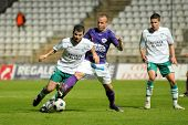 KAPOSVAR, HUNGARY - MAY 9: Pedro Sass (L) in action at a Hungarian National Championship soccer game