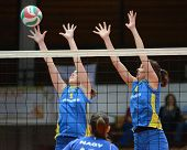 KAPOSVAR, HUNGARY - NOVEMBER 14: Zsanett Pinter (L) in action at the Hungarian NB I. League woman volleyball game Kaposvar vs Miskolc on November 14, 2010 in Kaposvar, Hungary.