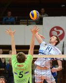 KAPOSVAR, HUNGARY - DECEMBER 8: Krisztian Csoma (R) strikes the ball at the Challenge Cup volleyball