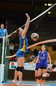 KAPOSVAR, HUNGARY - DECEMBER 19: Kamilla Gyorbiro (L) blocks the ball at the Hungarian NB I. League