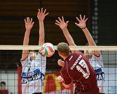 KAPOSVAR, HUNGARY - JANUARY 17: Krisztian Csoma (L) blocks the ball at a Hungarian volleyball Nation