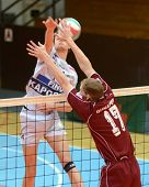 KAPOSVAR, HUNGARY - JANUARY 17: Krisztian Csoma (in white) blocks the ball at a Hungarian volleyball