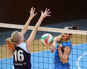KAPOSVAR, HUNGARY - JANUARY 14: Barbara Balajcza (R) strikes the ball at the Hungarian NB I. League