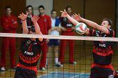 KAPOSVAR, HUNGARY - MARCH 6: Krisztian Csoma (R) blocks the ball at a Hungarian National Championshi