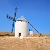 Two windmills. Castile La Mancha, Spain.