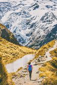 Hiking girl in New Zealand Mt Cook nature mountain. Alone hiker walking on popular trail Mueller Hut poster