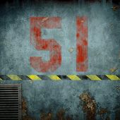 An image of a rusty metal background with the red number 51