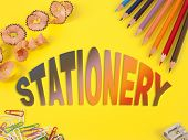 Some Colored Pencils Of Different Colors And A Pencil Sharpener And Pencil Shavings On The Yellow Ba poster