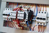 Two Contactors With Additional Contacts And Modular Circuit Breakers On The Mounting Panel In The El poster