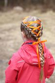 A Little Girl With Two Dutch Braids And Orange Ribbon. Hairstyles For Kids. poster