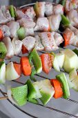 Chicken meats and vegetables on bbq