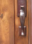 foto of door-handle  - Middle brown wooden door with metal handle - JPG