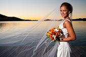 Beautiful Bride With Veil Extended At Sunset
