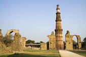 stock photo of qutub minar  - Forlorn structures around Qutub Minar victory tower in Delhi India Asia - JPG
