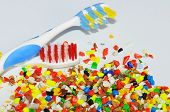 image of thermoplastics  - dyed and milled thermoplastic regrind with toothbrushes  - JPG