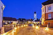 foto of sibiu  - small square and council tower in sibiu romania at night - JPG