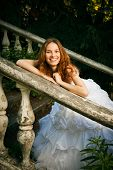 Bride Posing On Old Stairs