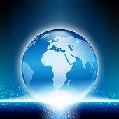 Shiny globe on blue background.