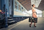 stock photo of old suitcase  - fair traveler with vintage suitcase at the station - JPG