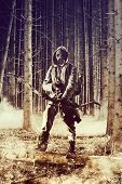 picture of war terror  - Soldier wearing a gas mask is fighting for its survival - JPG